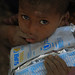 A child holding supplementary food provided by WFP at Lubakda Kebele of Kori Woreda in Afar Regional state.                                                           Lubakda, a remote site served by one of Afar's 20 Mobile Health and Nutrition Teams (MHNT