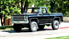 '70s GMC 4X4 (Eyellgeteven) Tags: old black classic chevrolet truck vintage gm shiny 4x4 pickup pickuptruck chevy vehicle 1970s gmc mismatch madeinusa americanmade fourwheeldrive lifted chev generalmotors k15 bigtires 12ton generalmotorscorporation shortbed mismatchedtires royalsierra eyellgeteven gmcroyalsierra