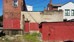 Cruger Way alley behind Penn Avenue at South Aiken, Garfield, Pittsburgh, September 24, 2015 (real00) Tags: abstract alley architecture chimney concrete contemporarylandscape corrosion debris decay deserted desolate dirt empty forlorn garfield geometric graffiti house landscape manalteredlandscape manmadelandscape neighborhood pittsburgh rubble rust rustbelt sky storageshed streetscene urban urbanfragment urbanlandscape urbanmicroscape wall windows