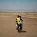 Clinical nurses Ermias Amare (front) and Salah Kedir, traveling on motorcycle between pastoral settlements