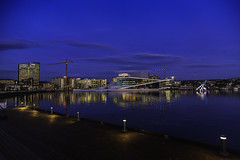 Oslo Opera house and Barcode (cpphotofinish) Tags: ocean travel blue light sky urban panorama color colour fall water yellow oslo norway night clouds canon landscape outside eos bay norge photo reflex opera cityscape foto nightshot image harbour outdoor mark tourist panoramic norwegian nightlight fjord nordic usm dslr havn bilder vann oslofjord bluelight kaia oslofjorden høst landskap bilde norske farger mk3 turist osloharbour operaen snøhetta vippetangen canonef ef24105mmf4lisusm bjørvika visitnorway oslooperahouse carstenpedersen canonmkiii mklll ef14mm eos5dmk3 oslobay cpphotofinish canonredlable oslonorgenorwayvinterwintersunsetgrassgresscanoncanon5dmkiiimk324105christmasxmasromjulafternoonshadowlightsunlightlightroom dslroslofjordfjord