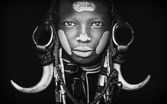 Poungalou, a young Mursi boy (Cyril Blanchard) Tags: voyage africa travel boy portrait people blackandwhite male beauty horizontal closeup blackbackground canon photography photo focus outdoor country young culture makeup tribal valley short tribes omovalley hunter horn tradition ethiopia tribe ethnic mursi hunt warthog afrique developing tribu nomade nomadic omo youngboy ethiopie traditionalclothing realpeople humanface nomades africanpeople oneboyonly africanethnicity 1people ethnie landscapeformat mursitribe indigenousculture nomadicpeople magonationalparc traditionallifestyle 85mm85mm onemaleonly murzu valléedelomo f12canon magopark southernnations omotribe symetricportrait indigeneousculture parcnationalmago warthoghorn personnesnomades personnenomade