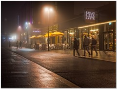 Town center mist (Hugh Stanton) Tags: pavement lamps street shops public