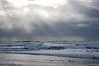 Shining through the cloud (YuriZhuck) Tags: or oregon us usa ocean sky shore nature light beam cloud coast wave