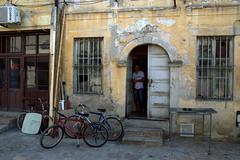 Workshop (el-Barrio) Tags: old shadow man guy work town bicycles workshop bazaar skopje