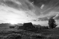 Moulton Sunset (jimmynotjim) Tags: park trees sunset sky bw sun mountain nature clouds barn landscape nationalpark hole farm grand moose row jackson flats national valley antelope kelly mormon wyoming wilderness teton tetons grandteton grasslands jacksonhole wy moulton mormonrow antelopeflats 500px ifttt