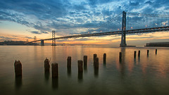 Dawning at the Dock of the Bay (Pat Charles) Tags: sanfrancisco california america usa unitedstates bayarea baybridge bridge dawn sunrise morning early outside outdoor tripod longexposure nikon water ocean reflection reflections reflected sea clouds embarcadero