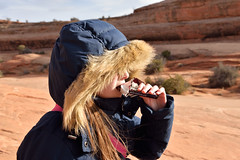 Energy Break (JasonCameron) Tags: kid girl coat bundled cold winter desert jauary hike climb adventure red rocks redrock southern utah arches national park delicate arch trail hersheys milk chocolate candy bar fingers hand hair fur hood