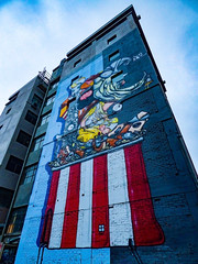 Let the Show Begin (Steve Taylor (Photography)) Tags: jacob yikes eye arab dtr stripes ladder art cartoon graffiti mural streetart building door scaffold scaffolding window blue red white man house newzealand nz southisland canterbury christchurch cbd city perspective sky shadow