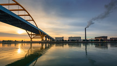Hoan Bridge (David Colombo Photography) Tags: ice lakefront milwaukee snow sunrise river frozen smokestack clouds sun hoanbridge bridge buildings icy cold winter yellow blue color reflection landscape nikon d800 davidcolombo davidcolombophotography outdoor sky water wisconsin