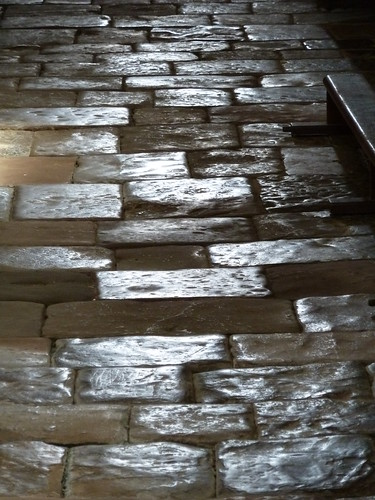 Texture of aisle flooring at Varen - natural light