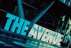 Walking Down The Avenue (Mister Oy) Tags: davegreen oyphotos ©oyphotos fujifilm provia outofdate film 35mm nikon f3 nikonf3 slide reversal crossprocessed crossprocessing avenue sign walking manchester street streetphotography streetphoto color colour urban blue spinningfields retro