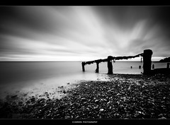 ____I_I_I_I_ (Kevin HARWIN) Tags: water sea beach sand stones rocks black white long exposure filter 66 seconds canon eos 70d sigma 1020mm lens reculver kent south east england britain uk