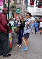 DSC01007 v2 (Wheels Down) Tags: nyc sunglasses couple legs candid smooth shades tourists twink sneakers timessquare shorts