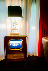 Television plays Elvis concerts at the Heartbreak Hotel on Elvis Presley Boulevard in Memphis Tennessee. (CarmenSisson) Tags: usa television vintage hotel tv antique memphis tennessee lodging lobby presley graceland touristattraction elvispresley heartbreakhotel cabinettv