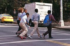 Kids crossing street, East Village (Patrick Copley) Tags: nyc people eastvillage film boys 35mm kodak streetphotography canonae1p ektar100 canonfd135mmf28
