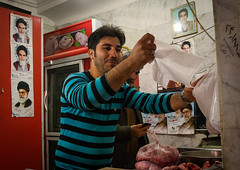 butcher in his shop decorated with ayatollah khomeini pictures, Golestan Province, Gorgan, Iran (Eric Lafforgue) Tags: portrait people man male men shop horizontal religious adult iran propaganda muslim islam middleeast persia meat indoors butcher hero posters males leader shia muharram iranian bazaar adults hussein oneperson iman hussain ayatollah gorgan midadultman golestanprovince 30sadult persiangulfstates khomeini  onemanonly waistup  16416 husayn colourimage 1people  iro  humanrepresentation westernasia