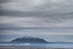 The last of the ice. (aamith) Tags: landscape nature lake water ice iceberg mountains blue sky clouds 105mm utah