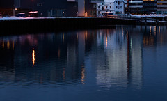 The blue hour in Tromsø harbor (Bente Nordhagen) Tags: tromsø by edgehotel havn speiling sea harbor reflectioninwater