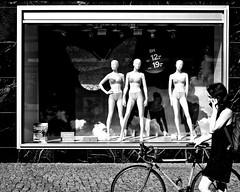 Here's looking at you, Kid! (floressas.desesseintes) Tags: berlin berlinmitte alexanderplatz schaufenster shopwindow ca unterwäsche lingerie bh bra büstenhalter mädchen girl jungefrau youngwoman fahrrad bicycle streetfotografie schwarzweis