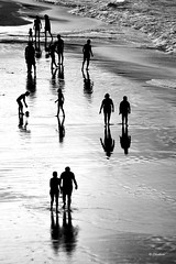 On the beach (2) (G.hostbuster (Gigi)) Tags: sea people bw beach reflections ghostbuster gigi49