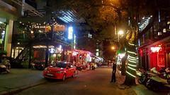 TOurist street (Roving I) Tags: trees streets tourism shopping bars restaurants vietnam nightlife hue motorscooters