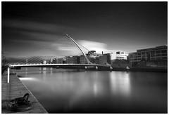 Looking Down the Liffey, Black and White (peter.guyan) Tags: longexposure bridge blue ireland dublin water clouds canon reflections river eos quay liffey beckett samual 24105mm 10stop nd30 leefilters 06nd eos5dmkii bigstopper