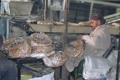 Preparing packs of bread for displaced families  in Ariha, Idlib (Ummah Welfare Trust) Tags: poverty children war islam aid hunger arab syria humanitarian إدلب، سوريا