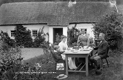group having scones, butter and jam at the Glencar Tea House, Co. Leitrim circa 1900 retouched (Old Irish Photo Rescue) Tags: tea house glencar leitrim ireland connacht connaught fashion hats scones chokers stoles china cups saucers check umbrella flowers freesias roses robert french william lawrence collection glass negative photographic project federation for ulster local studies fuls history societies 19th century cuppa national library