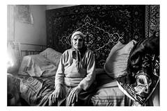 An elderly woman in her bedroom (Roman Lunin) Tags: ukraine ukrainians warinukraine war warphotography warconflict warcorrespondent civiliansatwar civilians elderly old oldpeople aged home peopleathome easternukraine frontline blackwhite blackandwhite bw blackwhitephoto blackwhitephotography monochrome