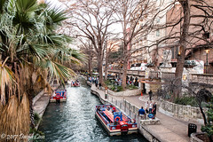 On the river (david_law44) Tags: sanantonio riverwalk trees aztectheater river sidewalks tourboats