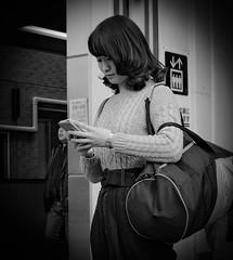 I hope she's texting me! (Bill Morgan) Tags: fujifilm fuji x100f bw jpeg lightroomcc street kichijoji tokyo