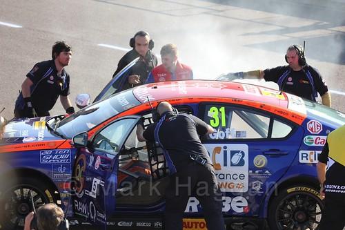 Jack Goff's smoky car in BTCC at Rockingham 2015