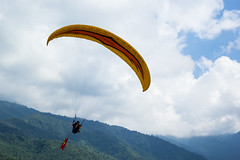 Paragliding - Vietwings Hanoi (huynoquy) Tags: travel blue autumn sky house mountain field sport canon vietnamese outdoor top sunny vietnam paragliding hanoi dreamer sunnyday parachute lightroom theworld hanoian canon60d mucangchai vietwings
