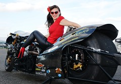 Holly_9806 (Fast an' Bulbous) Tags: top fuel bike motorcycle nitro fast speed power drag strip race track pits outdoor pinup model girl woman biker chick babe hot hotty sexy red shoes stilettos high heels black leather trousers pvc tight long brunette hair legs leggings