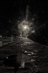 Sur le quai (Mare Crisium) Tags: port light lumière pavé stone pavement yellow jaune noir black obscur dark