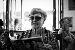 Nanny in Millthorpe (pnarsiman) Tags: grandparents grandpa grandma grandmother grandfather old people black white bw nikon d5300 35mm australia cafe reading newspaper magazine