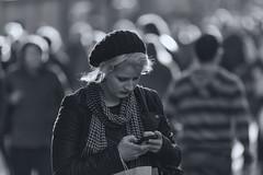 The need to keep in touch (Frank Fullard) Tags: frankfullard fullard candid street portrait commentary lady communicate lol mobile phone blackandwhite monochrome