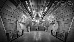 Symmetry (Adrian Court LRPS) Tags: england bw signs reflection london stairs underground lights unitedkingdom platform tunnel gb hdr southwark jubileeline undergroundstation