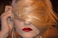 woman not wanting to be photographed (duncanfotos) Tags: nightphotography red woman night hair flash lips blonde youngwoman blondewoman adifferentpointofview