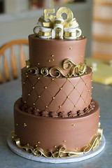 Chocolate & Gold 50th Anniversary Cake (Grace-ful Cakes) Tags: anniversary 50thanniversary anniversarycake chocolatebuttercream diamondpattern 50thanniversarycake gumpastebow golddragees goldlusterdust goldribboncake goldfondantribbon