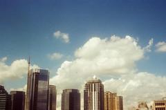 44990026 (alexdotbarber) Tags: sky color clouds analog skyscraper 35mm rangefinder f16 kodakgold100 1125 expiredfilm colorfilm colornegative petri7s 45mmf28 houstongalleria