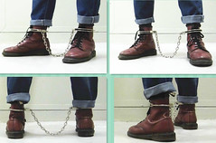 Doc Martens 8-eyes cherry red with leg irons locked over the boots (asiancuffs) Tags: handcuffs handcuffed shackles shackled boots