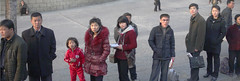 Bus Queue in Pyongyang (asenseof.wonder) Tags: panorama commuters bus city urban korea dprk northkorea 북한 조선 waiting winter woman student child man passing sidewalk queue jumpsuit tracksuit lineup publictransit public transit metro asia