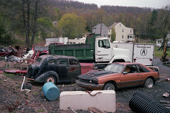 (patrickjoust) Tags: shenandoah pennsylvania schuylkillcounty abandoned car automobile fujicagw690 kodakportra400 6x9 medium format 120 rangefinder c41 color negative film manual focus analog mechanical patrick joust patrickjoust schuylkill county pa usa us united states north america estados unidos autaut small town coal country region broken down auto vehicle parked dump truck