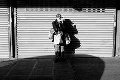 Waiting. (poopoorama) Tags: seattle street light shadow blackandwhite bw musician usa man washington market fujifilm pikeplacemarket busker x100t fujifriday fujifridayseattle
