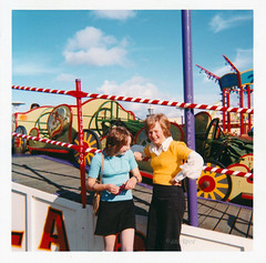 1970s girls at Southport Pleasureland (davekpcv) Tags: girls red beach yellow fair 1970s funfair southport pleasure pleasureland merseyside kodakinstamatic pleasurelandsouthport southportpleasurebeach