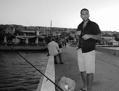 i was fishing she was shooting...didnt know (Georgios Rentzios) Tags: travel summer portrait people bw holiday black port island fishing outdoor greece kefallonia spiritofphotography