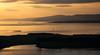Kerrera and Lismore lighthouse in sunset (Premysl Fojtu) Tags: uk sunset sea lighthouse seascape west water beautiful canon landscape island eos 350d evening bay coast scotland scenery view argyll shoreline atmosphere calm land coastline dreamy dslr atmospheric dreamscape lismore kerrera
