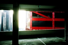Hong Kong car park (KnobsNotButtons) Tags: hongkong red carpark rangefinder film analogue streetphotography lomography crossprocess slide agfaprecisa nofilter 35mm urbanjungle olympus35rc